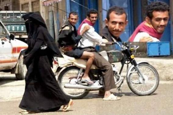 Men Ogling Woman in Burka